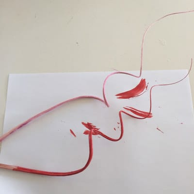 Red painted millinery quill